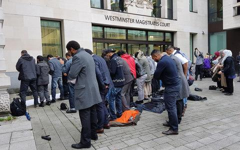People pray outside Westminster Magistrates Court - Credit: Tess Delamare/PA