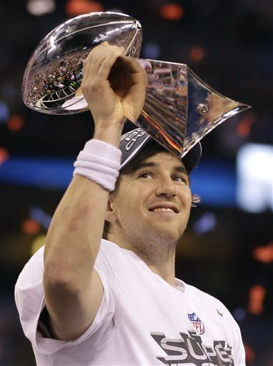 New York Giants quarterback Eli Manning holds up the Vince Lombardi Trophy while celebrating his team's 21-17 win over the New England Patriots in the NFL Super Bowl XLVI football game, Sunday, Feb. 5, 2012, in Indianapolis. (AP Photo/Matt Slocum)