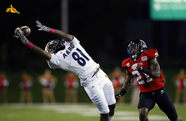 Akron wide receiver Tyrell Goodman (81) reaches for a pass as Northern Illinois cornerback Marlon Moore (21) defends during the second half of an NCAA college football game on Saturday, Oct. 12 , 2013, in DeKalb, Ill. (AP Photo/Jeff Haynes)