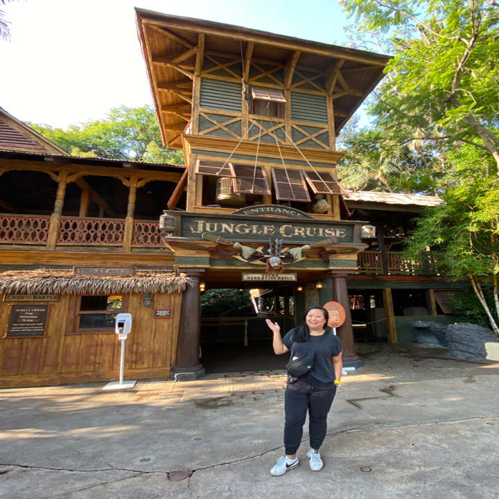 Me standing outside the entrance of the ride, which has a Jungle Cruise sign