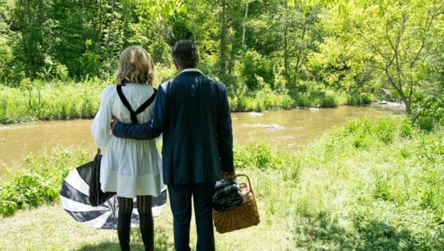 Moira and Johnny Rose ponder over the possibility of skinny dipping at one of the few pretty spots shown on the show