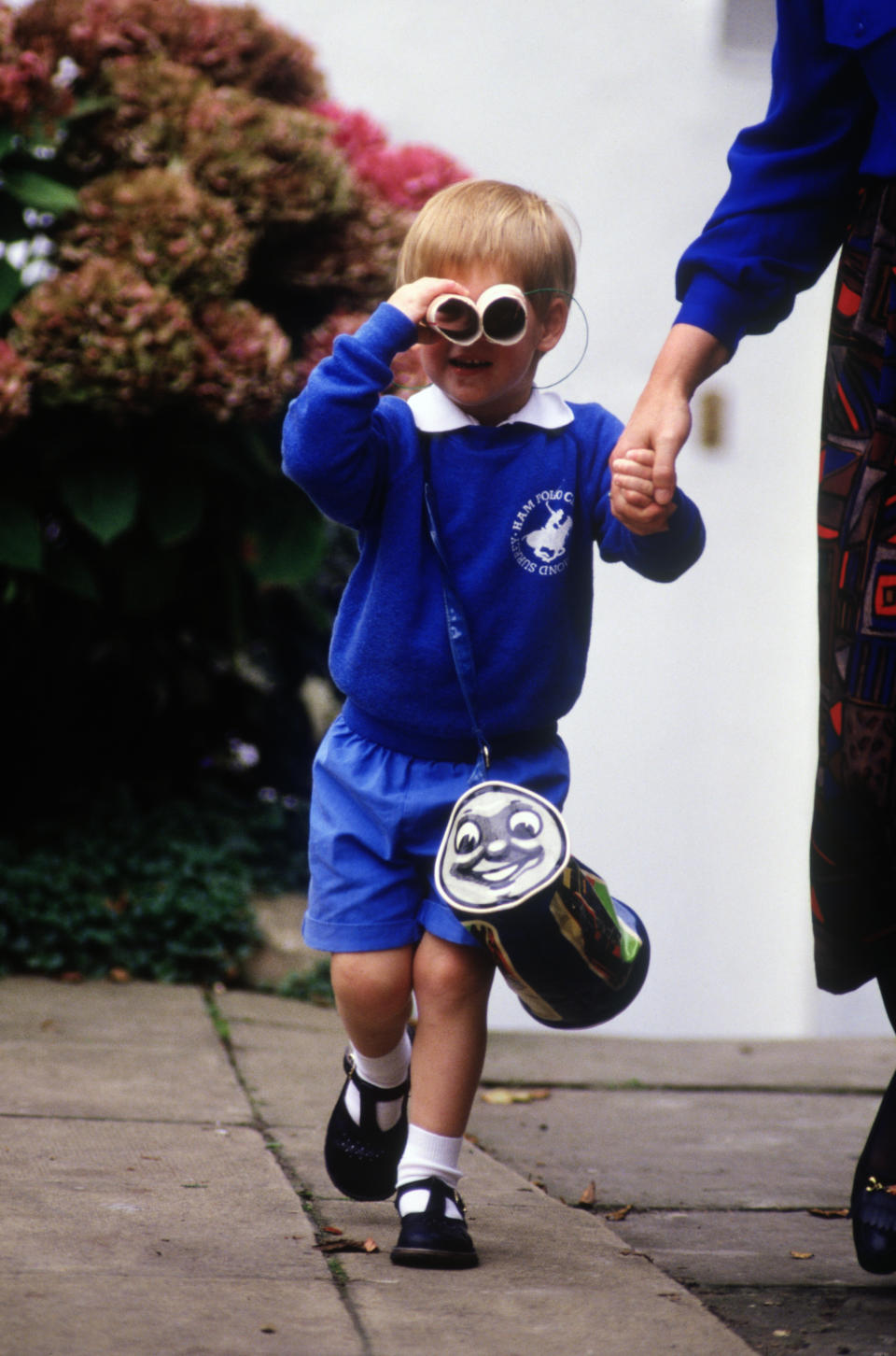 Prince Harry with his toilet roll binoculars after his first day at Mrs. Mynor's nursery school in 1987 in Notting Hill, London. (David Levenson/Getty Images)