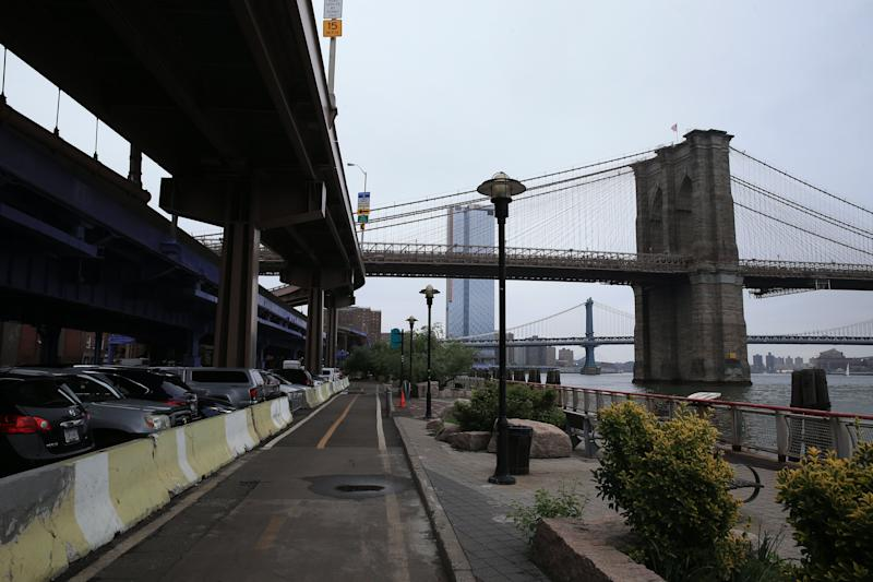 The Brooklyn Bridge along the East River waterfront at and above Fulton Street in the Financial District, Lower Manhattan. (Photo: Gordon Donovan/Yahoo News)