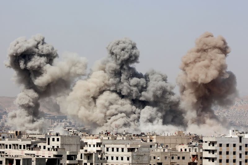 FILE PHOTO: Smoke rises after what activists said were air strikes by forces loyal to Syria's President Bashar al-Assad in Arbeen, in the eastern Damascus suburb of Ghouta