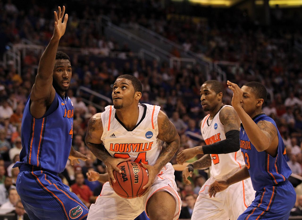 PHOENIX, AZ - MARCH 24:  Casey Prather #24 of the Florida Gators looks to shoot over Patric Young #4 of the Florida Gators during the 2012 NCAA Men's Basketball West Regional Final at US Airways Center on March 24, 2012 in Phoenix, Arizona.  (Photo by Jamie Squire/Getty Images)