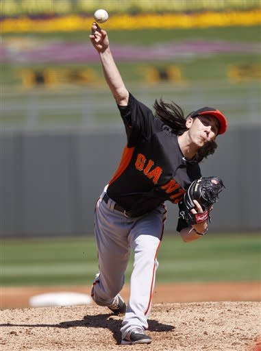 San Francisco Giants starting pitcher Tim Lincecum pitches during the third inning against the Kansas City Royals in a spring training baseball game, Tuesday, March 12, 2012, in Surprise, Ariz. (AP Photo/Lenny Ignelzi)