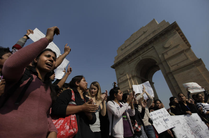 Indian and a few foreign women shout slogans in front of India Gate during a protest in New Delhi, India, Friday, Dec. 21, 2012. The hours-long gang-rape and near-fatal beating of a 23-year-old student by six men on a bus in New Delhi triggered outrage and anger across the country for the fifth day in a row, as Indians demanded action from authorities who have long ignored persistent violence and harassment against women. (AP Photo/Altaf Qadri)