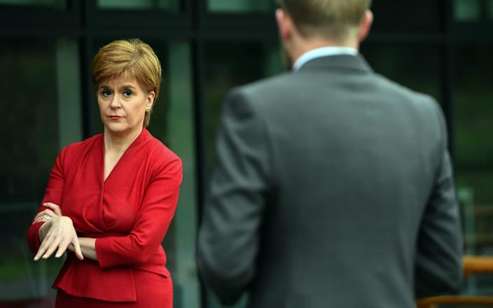 The First Minister visited West Calder High School on Monday, ahead of issuing her apology to students - WPA pool/Getty