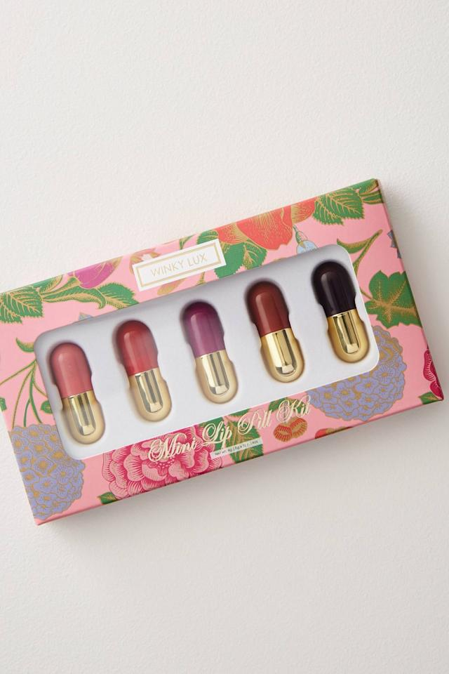 """<p>There's bound to be a color she loves in this <a href=""""https://www.popsugar.com/buy/Winky-Lux-Mini-Lip-Pill-Gift-Set-499879?p_name=Winky%20Lux%20Mini%20Lip%20Pill%20Gift%20Set&retailer=anthropologie.com&pid=499879&price=16&evar1=tres%3Aus&evar9=36064194&evar98=https%3A%2F%2Fwww.popsugar.com%2Flove%2Fphoto-gallery%2F36064194%2Fimage%2F46744505%2FSuch-Treat&list1=shopping%2Choliday%2Cwomen%2Cgift%20guide%2Cfriendship%2Cgifts%20for%20her%2Cgifts%20for%20women%2Cgifts%20for%20teens&prop13=mobile&pdata=1"""" rel=""""nofollow"""" data-shoppable-link=""""1"""" target=""""_blank"""" class=""""ga-track"""" data-ga-category=""""Related"""" data-ga-label=""""https://www.anthropologie.com/shop/winky-lux-mini-lip-pill-gift-set?category=all-gifts&amp;color=010&amp;type=STANDARD"""" data-ga-action=""""In-Line Links"""">Winky Lux Mini Lip Pill Gift Set</a> ($16).</p>"""