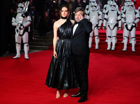 Actors Daisy Ridley and Mark Hamill pose for photographers as they arrive for the European Premiere of 'Star Wars: The Last Jedi', at the Royal Albert Hall in central London, Britain December 12, 2017. REUTERS/Hannah McKay
