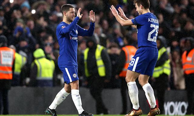 Eden Hazard (left) celebrates with César Azpilicueta after the Belgian scored the decisive penalty in the shootout against Norwich.
