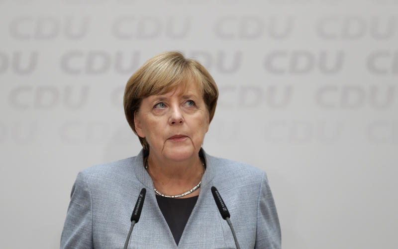 German Chancellor Angela Merkel ponders during a press conference after a board meeting of the Christian Democratic Union CDU in Berlin, Germany, Monday, Sept. 25, 2017, the day after the German parliament election. (AP Photo/Michael Sohn)