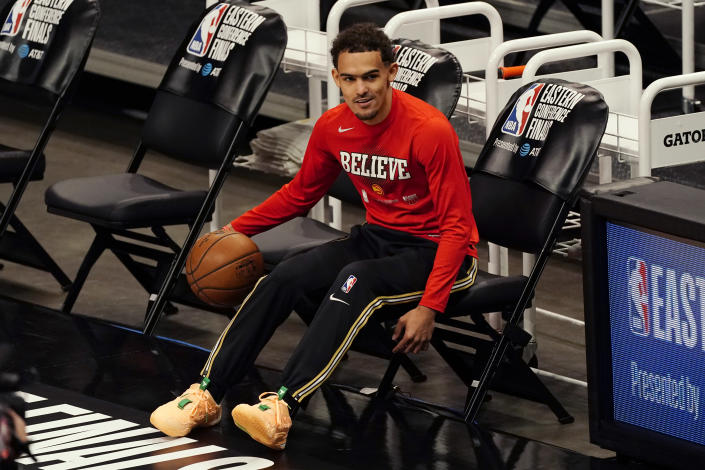 Atlanta Hawks guard Trae Young warms up before Game 6 of the team's NBA basketball playoffs Eastern Conference finals against the Milwaukee Bucks, Saturday, July 3, 2021, in Atlanta. (AP Photo/John Bazemore)