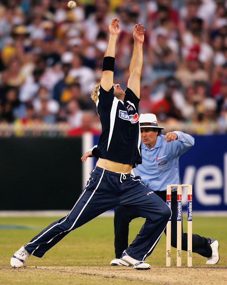 MELBOURNE, AUSTRALIA - JANUARY 10:   Daniel Vittori of the ICC Rest of the World XI attempts to take a catch off his own bowling as umpire Billy Bowden ducks for cover during the World Cricket Tsunami Appeal match between the ICC Rest of the World XI and the Asian XI at the MCG on January 10, 2005 in Melbourne, Australia. (Photo by Mark Dadswell/Getty Images)