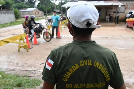 At the Umariacu reserve, the Ticuna people banned outsiders and put up a makeshift roadblock at the entrance of their territory to protect against the coronavirus -- a difficult but necessary choice