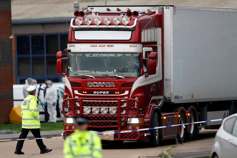 Police move the lorry container where bodies were discovered, in Grays, Essex, Britain October 23, 2019. REUTERS/Peter Nicholls