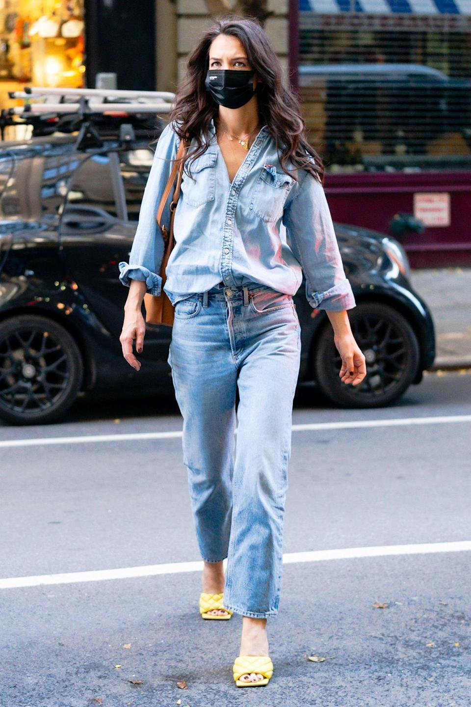 <p>Katie Holmes wears denim on denim with chic yellow mules while out in N.Y.C. on Monday.</p>