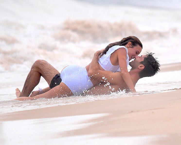Newlyweds Laura Perlongo and Nev Schulman share a romantic moment on the shoreline. (Photo: Splash)