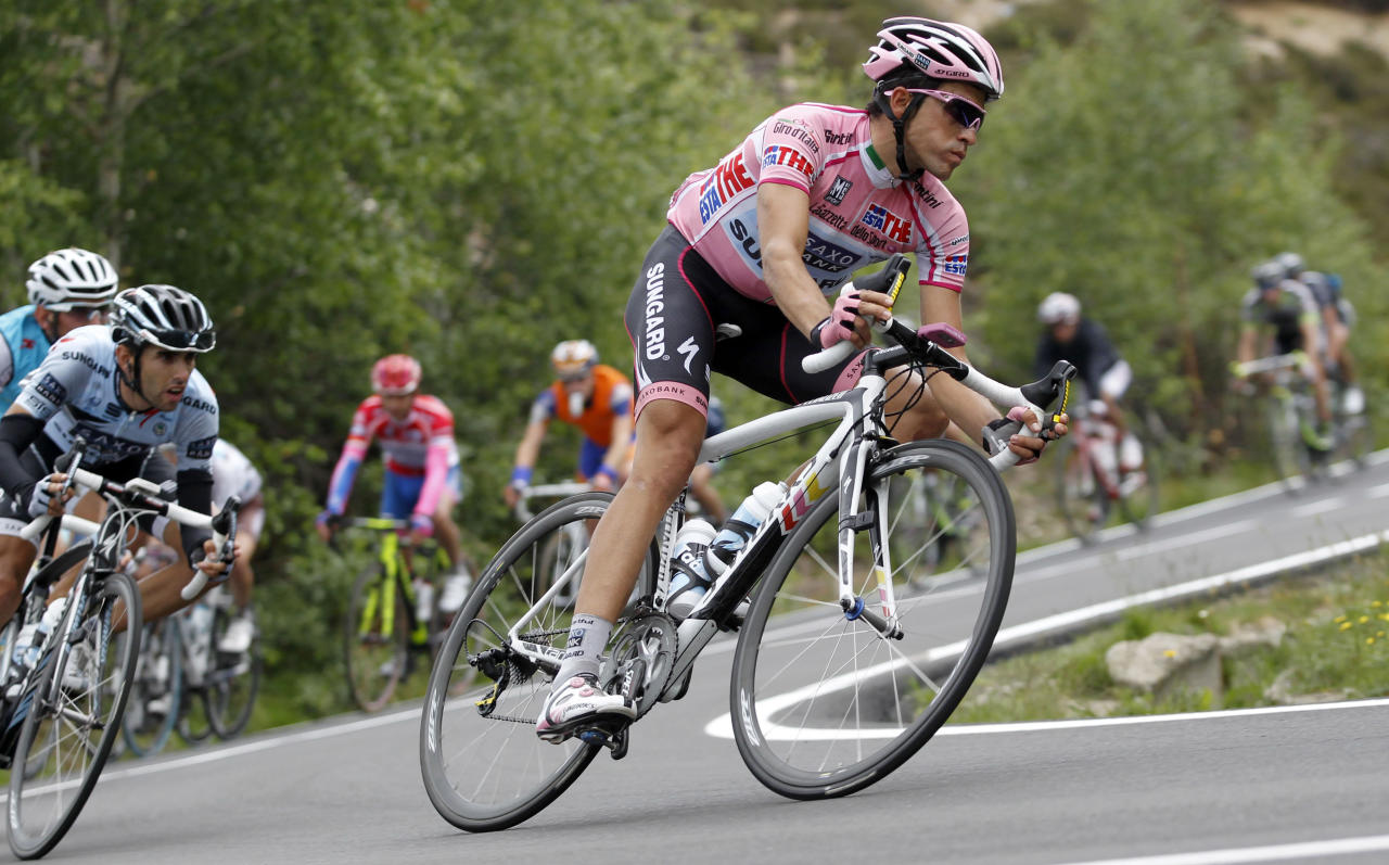File - In this May 27, 2011 file photo Spain's Alberto Contador, right, leads the pack during the 19th stage of the Giro d'Italia, Tour of Italy cycling race near Macugnaga, Italy. Sport's highest court on Monday Feb. 6, 2012 has banned Contador for two years after finding the Spanish cyclist guilty of doping, a decision that will strip the 2010 Tour de France champion of his title.The Court of Arbitration for Sport has suspended Contador after rejecting his claim that his positive test for clenbuterol was caused by eating contaminated meat.Contador has continued racing since giving a positive control on a 2010 Tour rest day, and is expected to be stripped of all of his results over the past 17 months including winning the Giro d'Italia last season. (AP Photo/Alessandro Trovati, File)