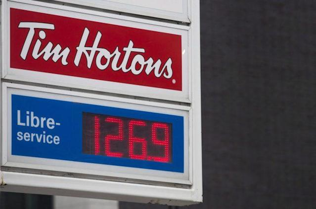 A sign for gas prices is shown at a filling station in Montreal, Wednesday, April 12, 2017. (THE CANADIAN PRESS/Graham Hughes)