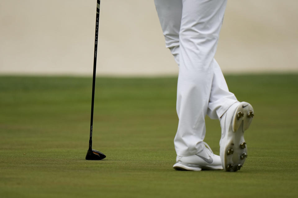 CORRECTS SPELLING OF NAME TO SI, NOT IS - Si Woo Kim, of South Korea, leans on his 3 wood which he had to use to putt on the 16th green during the second round of the Masters golf tournament on Friday, April 9, 2021, in Augusta, Ga. (AP Photo/Matt Slocum)