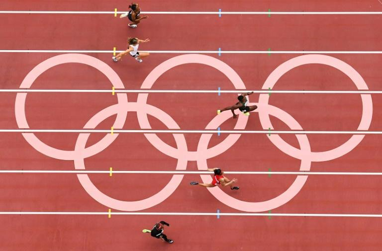 Athletes compete in the women's 100m heats