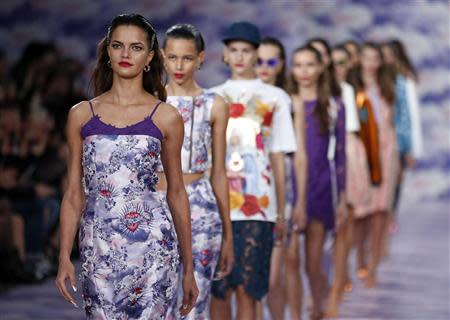 Models present creations from the House of Holland Spring/Summer 2014 collection during London Fashion Week September 14, 2013. REUTERS/Suzanne Plunkett