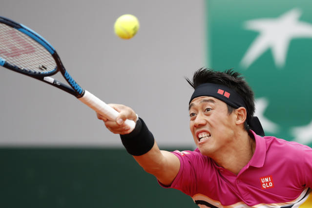 Japan's Kei Nishikori plays a shot against France's Quentin Halys during their first round match of the French Open tennis tournament at the Roland Garros stadium in Paris, Sunday, May 26, 2019. (AP Photo/Christophe Ena)