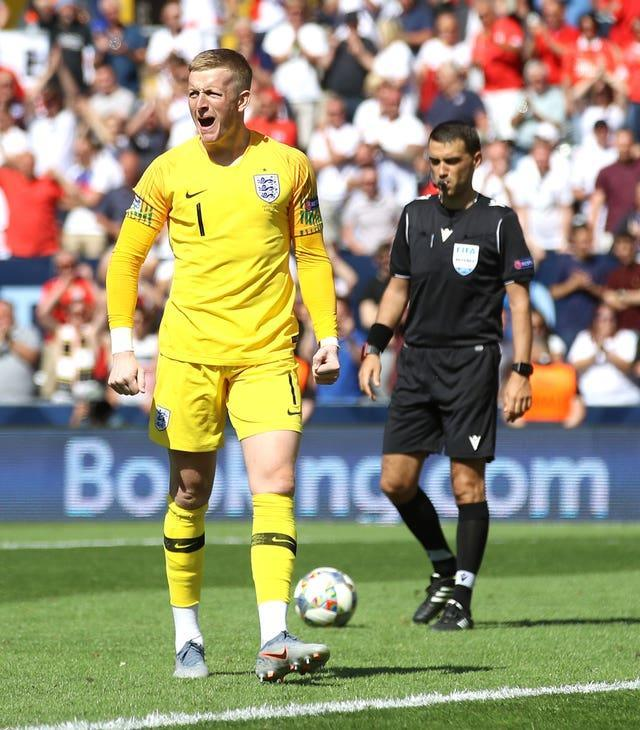 Jordan Pickford celebrates scoring a penalty in a Nations League third-place play-off shootout against Switzerland