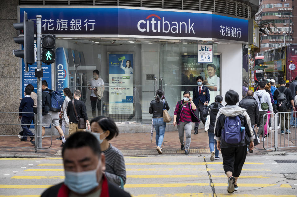 HONG KONG, CHINA - 2021/03/21: Pedestrians cross the street at a traffic light in front of the American multinational investment bank, Citibank or Citi, branch in Hong Kong. (Photo by Budrul Chukrut/SOPA Images/LightRocket via Getty Images)