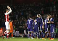 Anderlecht players (R) celebrate at the end of their UEFA Champions League Group D match against Arsenal, at the Emirates Stadium in north London, on November 4, 2014 (AFP Photo/Adrian Dennis)
