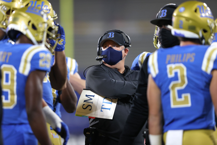 PASADENA, CALIFORNIA - DECEMBER 12: Head coach Chip Kelly of the UCLA Bruins looks on.