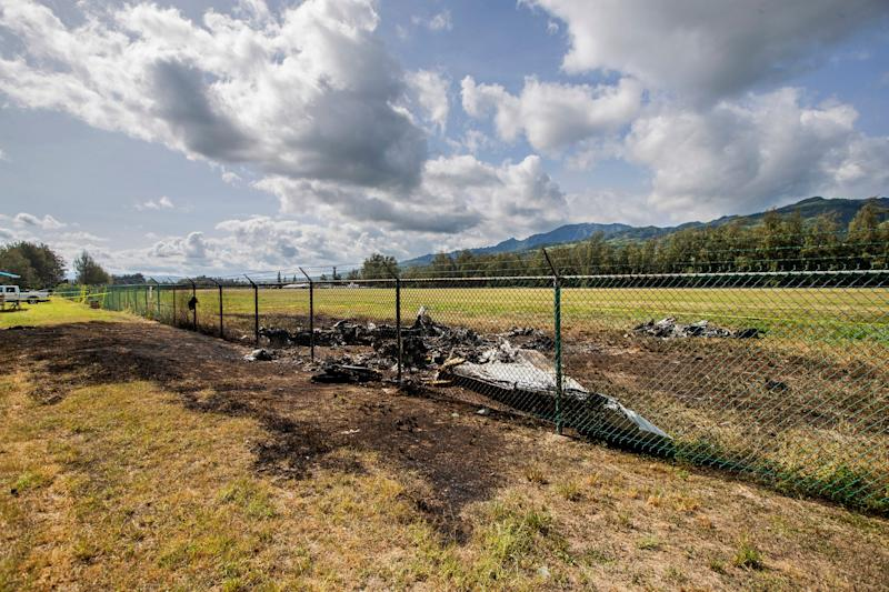 In this June 22, 2019 file photo, the charred remains of a skydiving plane that crash on Oahu's North Shore are shown near Waialua, Hawaii. The skydiving company that was operating a plane that crashed and killed 11 people last month did not have the proper state permits to take people skydiving.