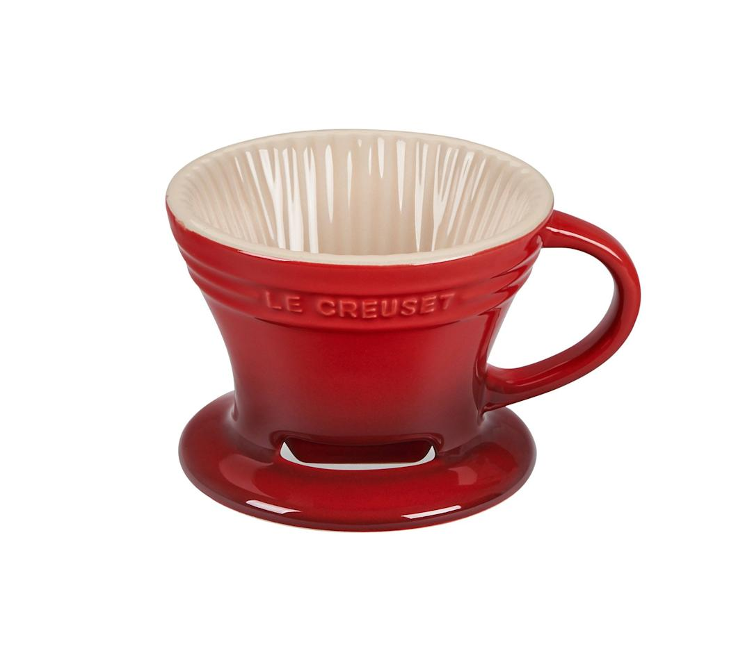 """<p>Place this pretty cone over almost any mug (it fits most standard sizes) for an instant pour-over coffee maker. Simply follow the magic pour-over formula to get delicious coffee straight into your favorite mug, no bulky machine necessary.</p> <p><strong>To buy:</strong> $25; <a href=""""https://www.pjtra.com/t/8-9049-131940-87165?sid=RS%2C6CleverItemstoSimplifyYourLife%252809%252F20%252F2019%2529%2Clphillips1271%2CLIF%2CIMA%2C673757%2C201909%2CI&url=https%3A%2F%2Fwww.lecreuset.com%2Fpour-over-coffee-cone"""" target=""""_blank"""">lecreuset.com.</a></p>"""