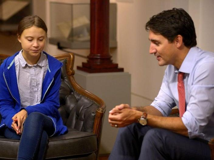 Canadian Prime Minister Justin Trudeau, right, sits down with Swedish climate change activist Greta Thunberg, in Montreal, in 2019 (Reuters)