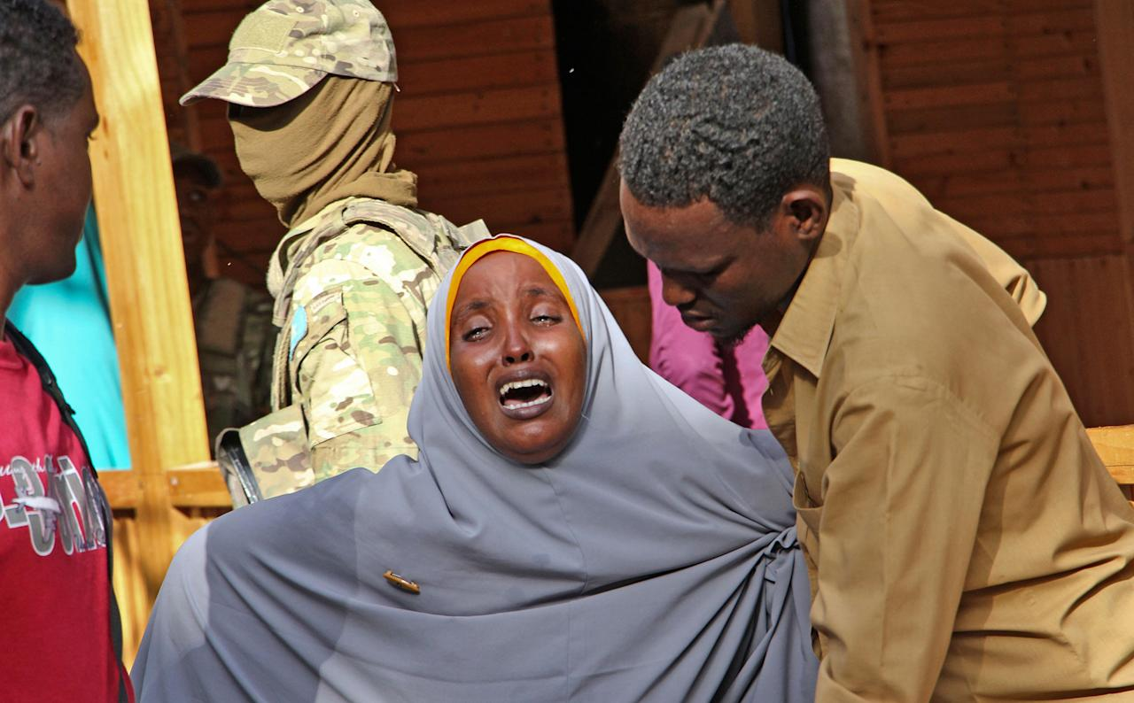 <p>A mother whose daughter was shot in the head by attackers during a militant attack on a restaurant, grieves in Mogadishu, Somalia Thursday, June 15, 2017. (Photo: Farah Abdi Warsameh/AP) </p>