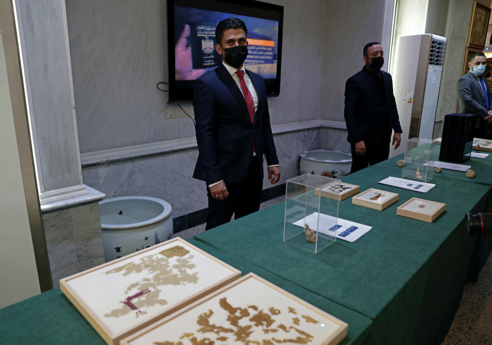 Recently recovered antiquities are displayed at the foreign ministry, in Baghdad, Iraq, Tuesday, Aug. 3, 2021. Over 17,000 looted ancient artefacts recovered from the United States and other countries were handed over to Iraq's Culture Ministry on Tuesday, a restitution described by the government as the largest in the country's history. The majority of the artefacts date back 4,000 years to ancient Mesopotamia and were recovered from the U.S. in a recent trip by Prime Minister Mustafa al-Kadhim. (AP Photo/Khalid Mohammed)