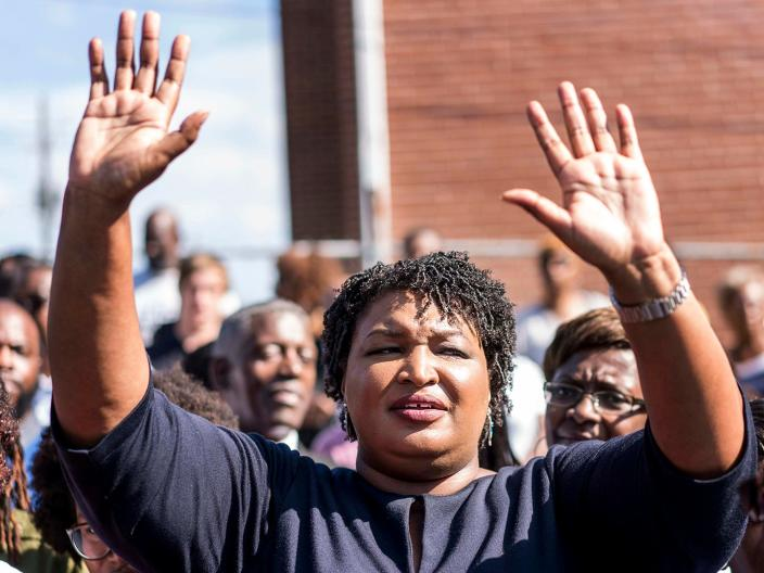 Stacey Abrams campaigning across Georgia on the first day of early voting outside the Ebenezer Missionary Baptist Church in Macon, Georgia on October 15, 2018.