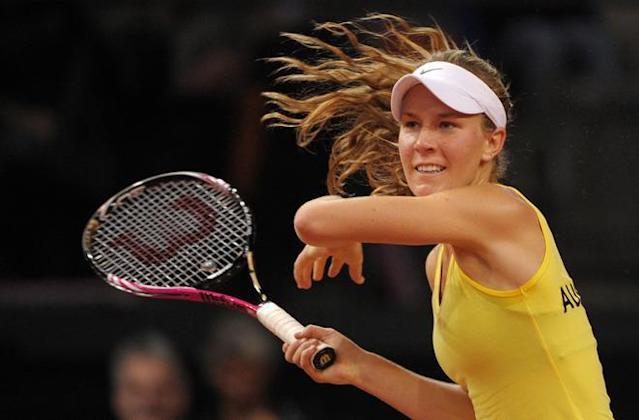 Australia's Olivia Rogowska returns a ball to Germany's Angelique Kerber at the Fed Cup play-off tie between Germany and Australia in Stuttgart, on April 22, 2012. Kerber won 6-3, 6-3. AFP PHOTO / MARIJAN MURAT GERMANY OUT