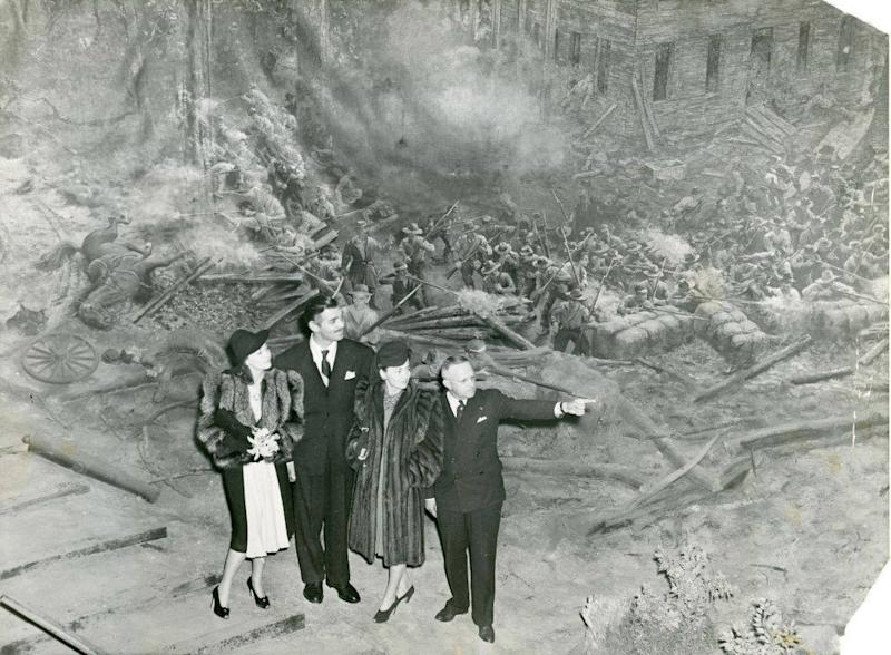 In this Dec 16, 1939 photo, Vivien Leigh, Clark Gable, Olivia DeHaviland and George Simons visit Cyclorama, a colossal panoramic painting depicting the Battle of Atlanta from the American Civil War, during the Gone with the Wind premiere, in Atlanta. The painting will soon be moved from the building where it has been displayed for nearly a century. Historians said moving the 6-ton Cyclorama from Grant Park to the Atlanta History Center across town marks a major milestone in its restoration. The move is to begin Thursday, Feb. 9, 2017. (Atlanta Journal-Constitution via AP)