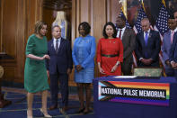 House Speaker Nancy Pelosi, D-Calif., is joins members sign the bill to create the National Pulse Memorial to honor the victims of the 2016 mass shooting at the Pulse nightclub in Orlando, at the Capitol in Washington, Wednesday, June 16, 2021. From left are Rep. David Cicilline, D-R.I., Rep. Val Demings, D-Fla., and Rep. Stephanie Murphy, D-Fla. The shooting was the deadliest attack on the LGBTQ community in U.S. history and left 49 people dead. (AP Photo/J. Scott Applewhite)