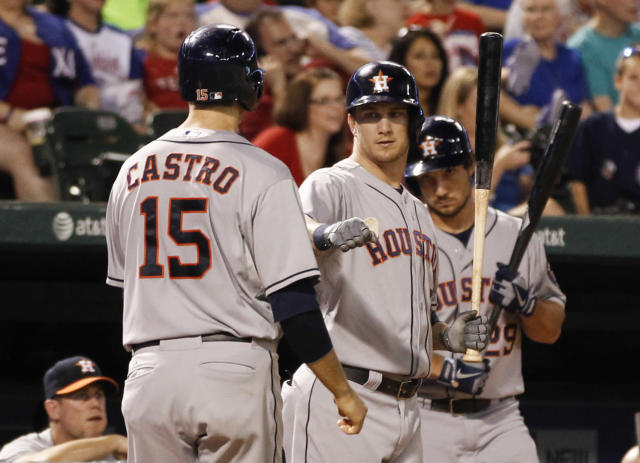 Houston Astros' Jason Castro (15) is congratulated by Brandon Barnes, center, after scoring a run against the Texas Rangers during the seventh inning of a baseball game, Wednesday, Aug. 21, 2013, in Arlington, Texas. (AP Photo/Jim Cowsert)