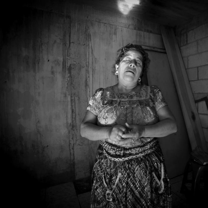 <p>Healer Josefina Vazquez de Gonzalez holds her sacred bone for healing. The bone must always be covered and cannot be revealed to anyone. (Photograph by Fran Antmann) </p>