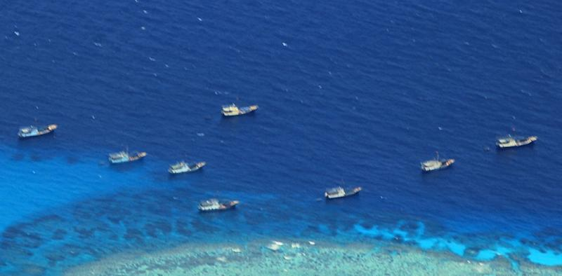 Chinese fishing vessels are seen anchored at Fiery Cross reef on the disputed Spratly islands