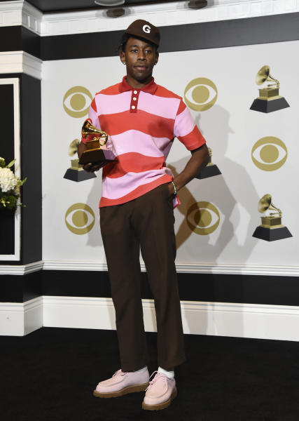 """Tyler, The Creator poses in the press room with the award for best rap album for """"Igor"""" at the 62nd annual Grammy Awards at the Staples Center on Sunday, Jan. 26, 2020, in Los Angeles. (AP Photo/Chris Pizzello)"""