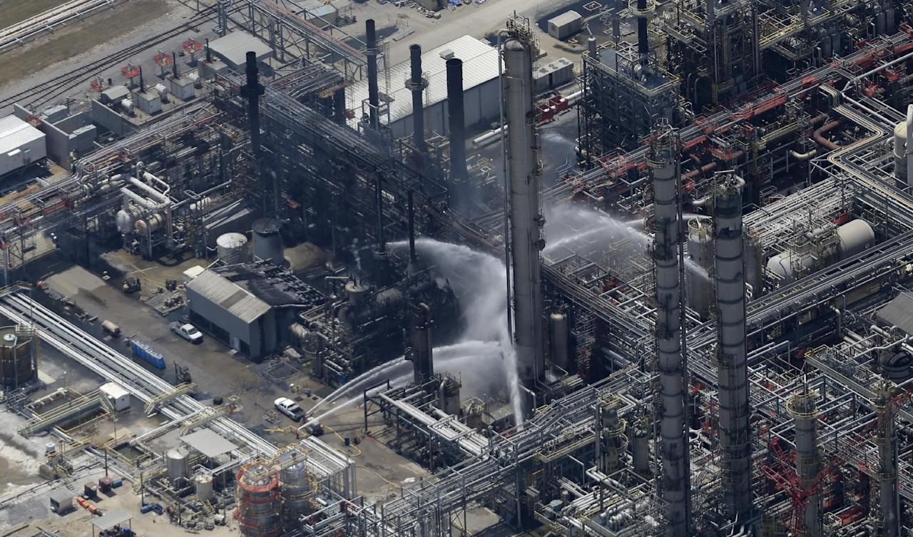 A chemical plant fire is seen in this aerial photo about twenty miles southeast of Baton Rouge, in Geismer, La., Thursday, June 13, 2013. Ambulances and helicopters took at least 30 people from the burning chemical plant after an explosion Thursday, officials said. Early tests did not indicate dangerous levels of any chemicals around the plant, but area residents were told to remain indoors with doors and windows closed, said Jean Kelly, spokeswoman for the state Department of Environmental Quality. (AP Photo/Gerald Herbert)