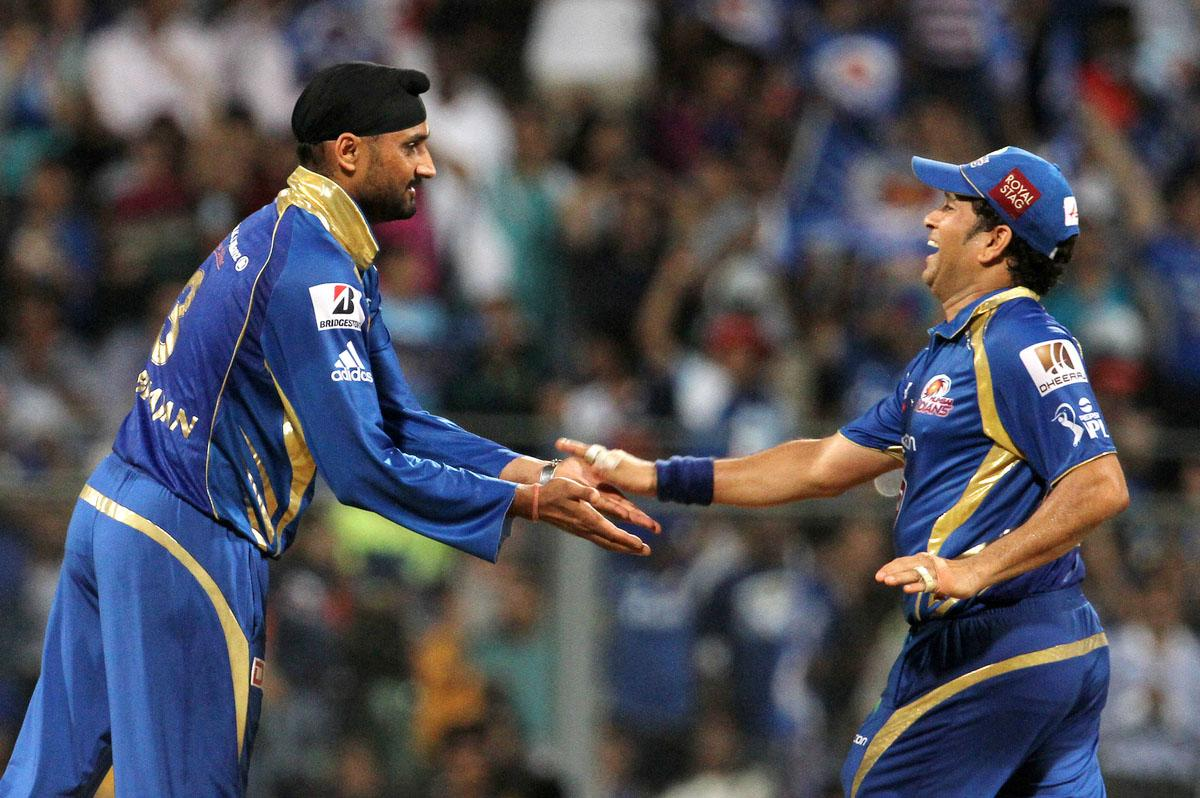 Mumbai Indian player Harbhajan Singh celebrates with Mumbai Indian player Sachin Tendulkar after he takes the wicket  Kings XI Punjab player Manpreet Gony during match 41 of the Pepsi Indian Premier League ( IPL) 2013 between The Mumbai Indians and the Kings XI Punjab held at the Wankhede Stadium in Mumbai on the 29th April 2013. (BCCI)
