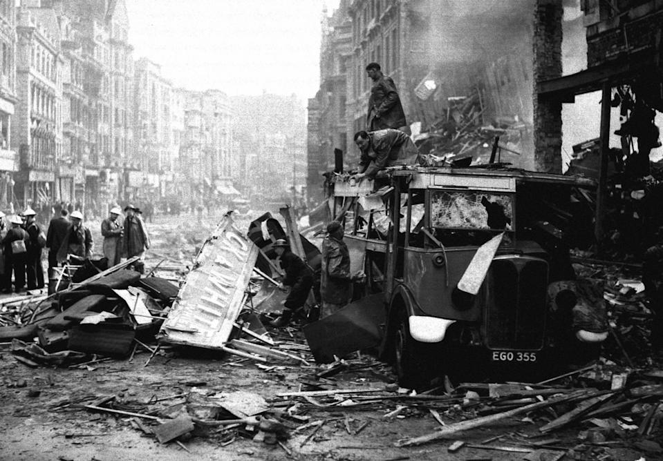 Rescue workers attend to a badly damaged bus in High Holborn, London, amid the damage caused by a Luftwaffe bombing raid during the blitz.