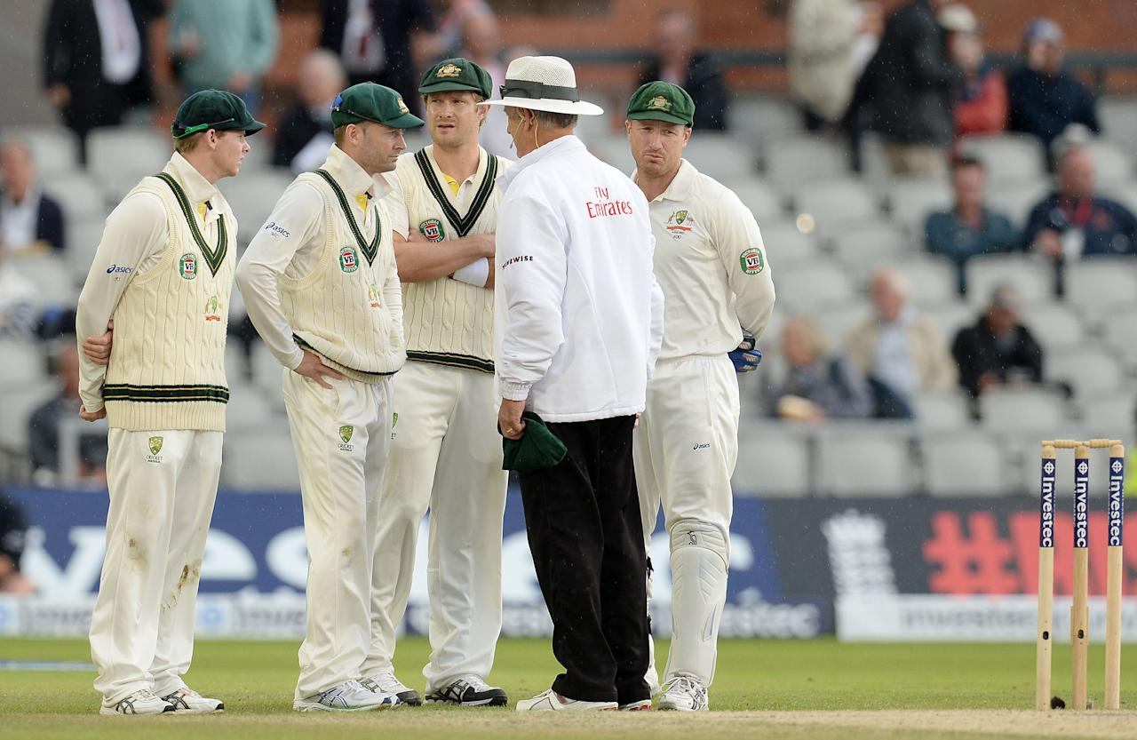 Australia's Michael Clarke talk with umpire Tony Hill as rain stops play, during day five of the Third Investec Ashes test match at Old Trafford Cricket Ground, Manchester.