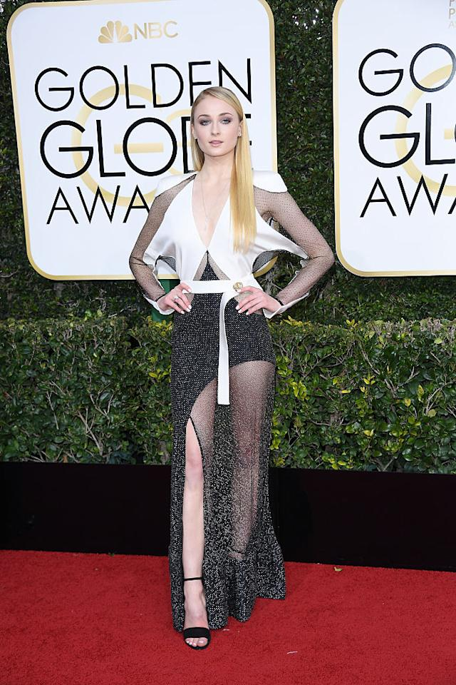 """<p>The <i>Game of Thrones</i> actress wore a long-sleeved gown that featured a high slit and embellished panels to the 74th Annual Golden Globe Awards. On her look for the night, the star's stylist, Rebecca Corbin-Murray, told <i>Teen Vogue</i>, """"Sophie's dress was the closing look at the Louis Vuitton Spring 2017 show, and we both fell in love with it instantly."""" (Photo: Getty Images) </p>"""